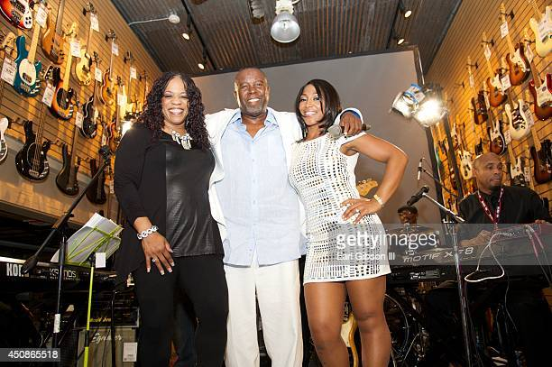 """Performers Evelyn """"Champagne"""" King, Kashif and Myracle Holloway pose for a photo during Black Music Month at Sam Ash Music Store on June 18, 2014 in..."""