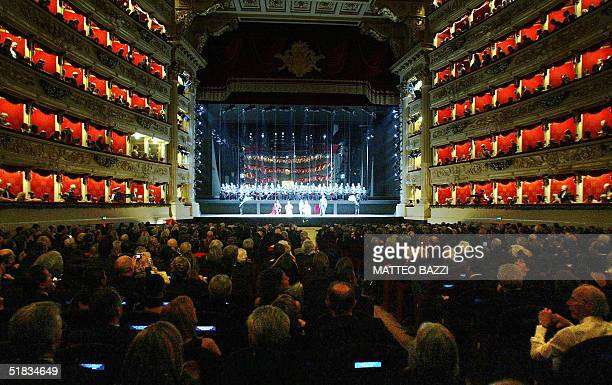Performers fill the stage at La Scala opera house in Milan during the official inauguration for the reopening of the restored opera to its former...