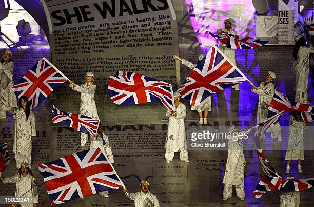Performers fly Union Jack flags during the Closing Ceremony on Day 16 of the London 2012 Olympic Games at Olympic Stadium on August 12 2012 in London...