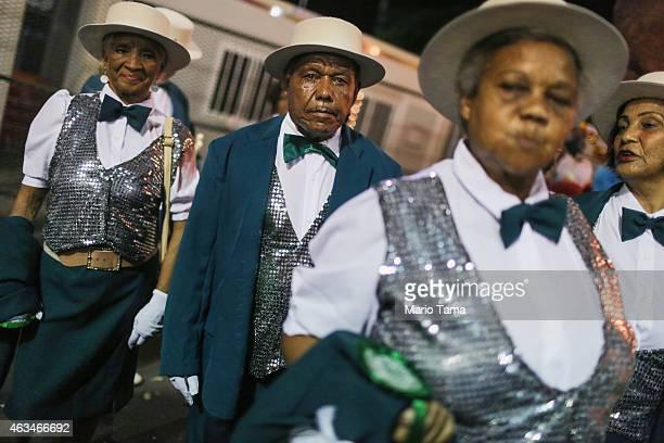 Performers for the Academicos de Santa Cruz samba school pose as they prepare to parade outside the Sapucai Sambodrome on February 14 2015 in Rio de...