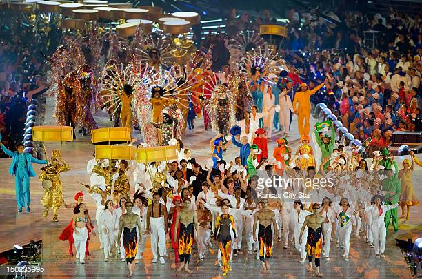 Performers for the Rio de Janerio 2016 Olympics segment walked across the stage during the Closing Ceremony at Olympic Stadium during the 2012 Summer...