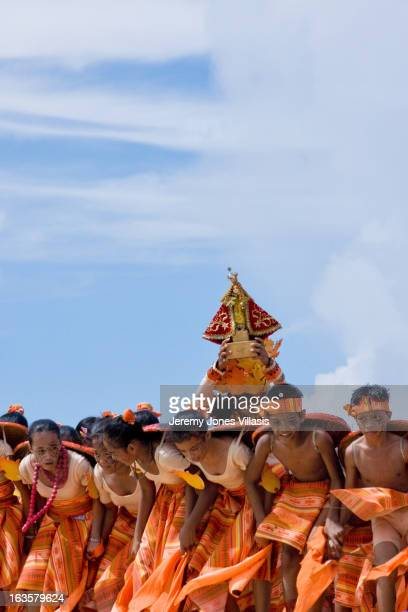 Performers from a local school carry the image of the Sto. Niño, the child Jesus, during the dance competition of the Pintados-Kasadyaan Festival in...
