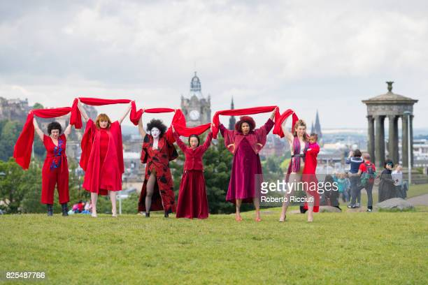 Performers from 'Dr Carnesky's Incredible Bleeding Women' show attend a photocall at Calton Hill during the Edinburgh Festival Fringe on August 2...