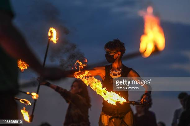 Performers from Fire Club Edinburgh mark the summer solstice during a fire festival on Calton Hill on June 21, 2021 in Edinburgh, United Kingdom. The...