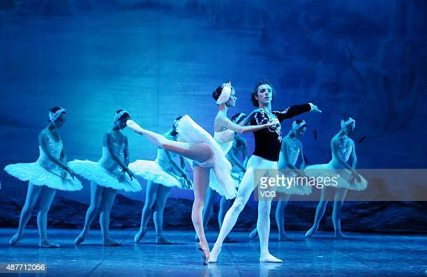 Performers from Russian State Ballet dance 'Swan Lake' on the stage at Mei Lanfang Theatre on September 10 2015 in Beijing China
