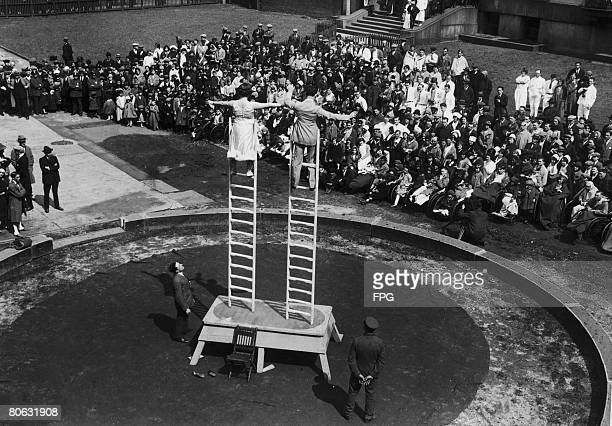 Performers from the Barnum and Bailey's Ringling Bros circus putting on a show for patients at the Bellevue Hospital in New Jersey circa 1920