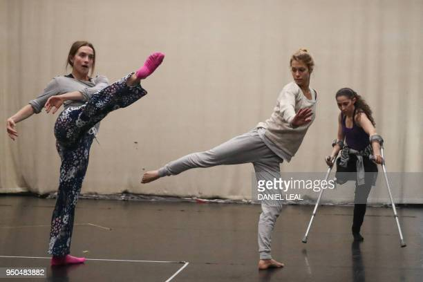Performers from the Candoco contemporary dance company rehearse their new show in north London on April 13, 2018. - Whether in a wheelchair, on...