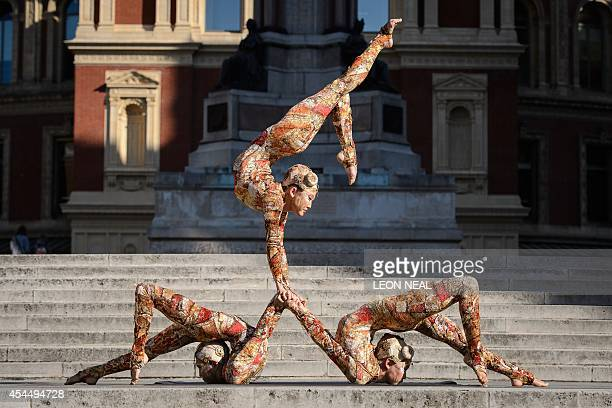 Performers from the Cirque du Soleil pose for photographers during a press call to promote their forthcoming show 'Kooza' outside the Royal Albert...