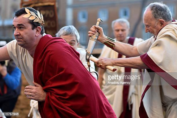 Performers from the Gruppo Storico Romano take part in a show reenacting the assassination of Julius Caesar in Rome Italy on March 16 2016 to marking...