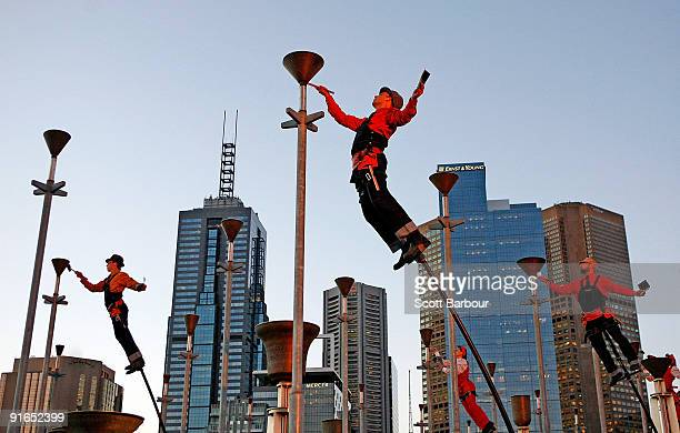Performers from the theatre company Strange Fruit ring bells as they perform Ringing The Changes during the official launch for the Melbourne...
