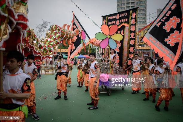 Performers get ready for a parade for the Hungry Ghost Festival in Hong Kong on August 22 2013 The festival celebrated in the seventh lunar month of...