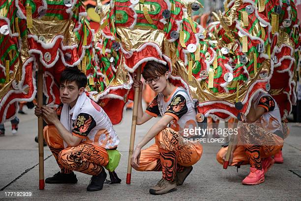 Performers hold a dragon during a parade for the Hungry Ghost Festival in Hong Kong on August 22, 2013. The festival, celebrated in the seventh lunar...