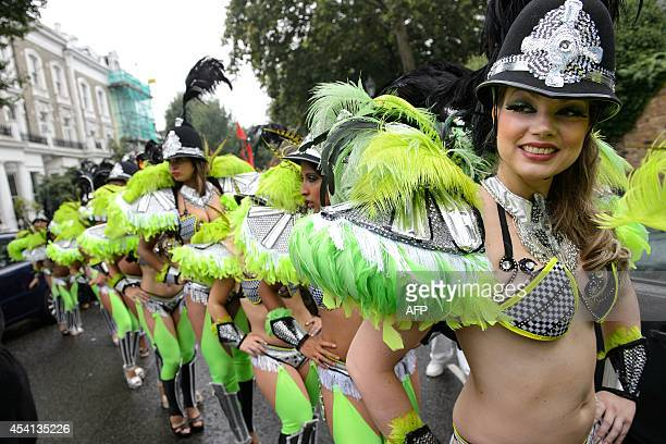 Performers in costume prepare to take part in the parade on the second day of the Notting Hill Carnival in London on August 25 2014 Heavy rain...