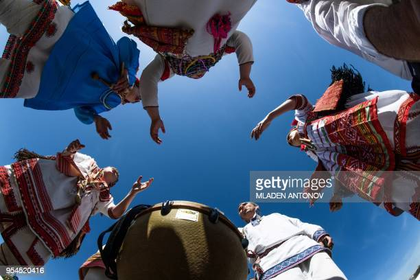 TOPSHOT Performers in traditional costumes sing for tourists in Saransk on May 4 2018 Saransk will host several games of the 2018 FIFA World Cup