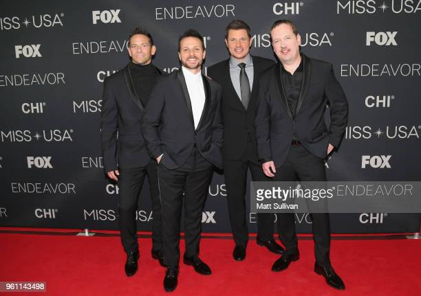 Performers Jeff Timmons Drew Lachey Nick Lachey and Justin Jeffre of 98 Degrees pose for pictures on the red carpet at the Shreveport Convention...