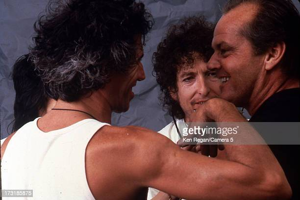 Performers Keith Richards and Bob Dylan are photographed with Jack Nicholson backstage at Live Aid on July 13 1985 at JFK Stadium in Philadelphia...