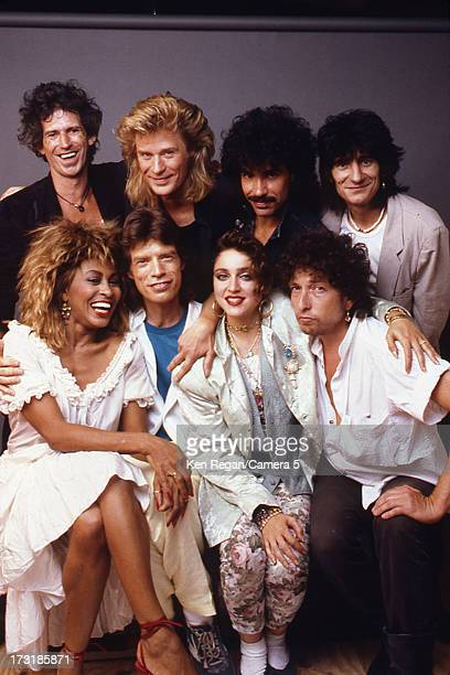 Performers Keith Richards Daryl Hall John Oates Ron Wood Tina Turner Mick Jagger Madonna and Bob Dylan are photographed backstage at Live Aid on July...