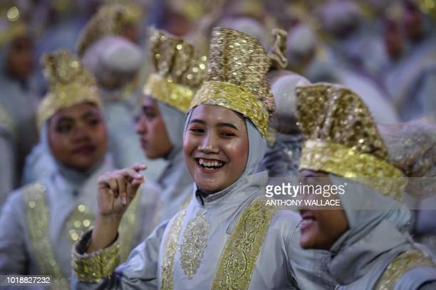 TOPSHOT Performers laugh as they wait to take part at the opening ceremony of the 2018 Asian Games in Jakarta on August 18 2018
