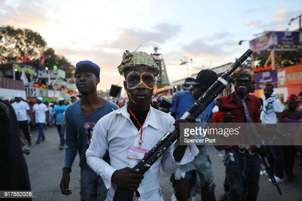 Performers march through the streets of PortauPrince during the second day of Carnival on February 12 2018 in PortauPrince Haiti Haiti the poorest...