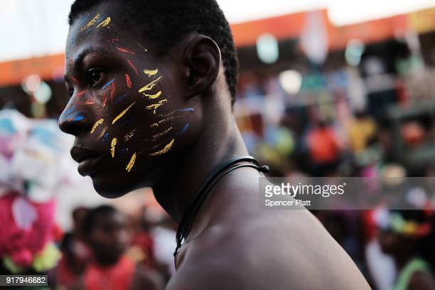 Performers march through the streets of PortauPrince during the last day of Carnival on February 13 2018 in PortauPrince Haiti Haiti the poorest...