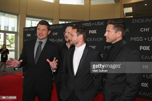 Performers Nick Lachey Justin Jeffre Drew Lachey and Jeff Timmons of 98 Degrees speak with the media on the red carpet at the Shreveport Convention...