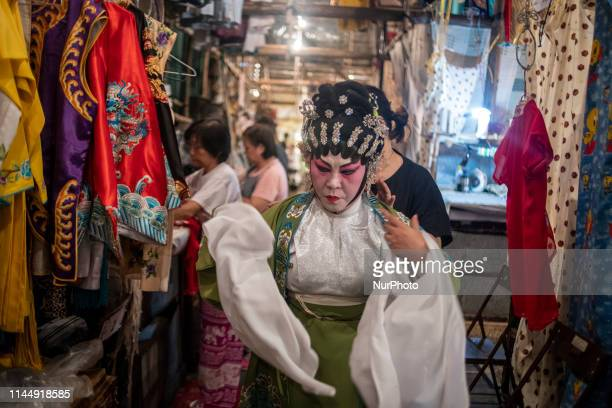 A performers of a Cantonese Opera is seen putting on her costume inside the Bamboo Theatre in Hong Kong China 19 May 2019