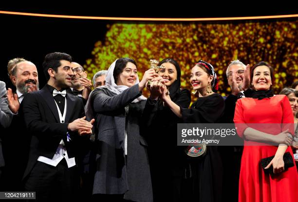 Performers of Iranian director Muhammed Rasoulof's movie âSheytan Vojud Nadarad❠are seen after won the Golden Bear Award at the 70th International...
