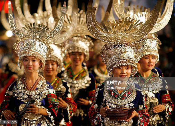 Performers of Miao ethnic origin dressed in traditional costumes attend the opening ceremony of the 18th Shanghai Tourism Festival along Huaihai Road...
