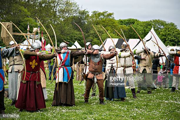 performers on medieval market in denmark - longbow stock photos and pictures
