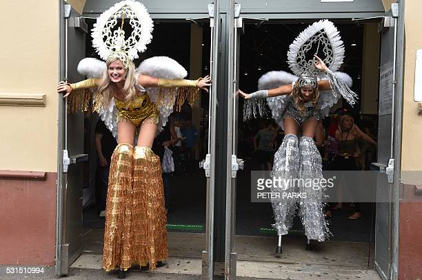 Performers on stilts leave one of the halls at the Sexpo Sydney 2016 exhibition in Sydney on May 15 2016 Sydney's adult entertainment and lifestyle...