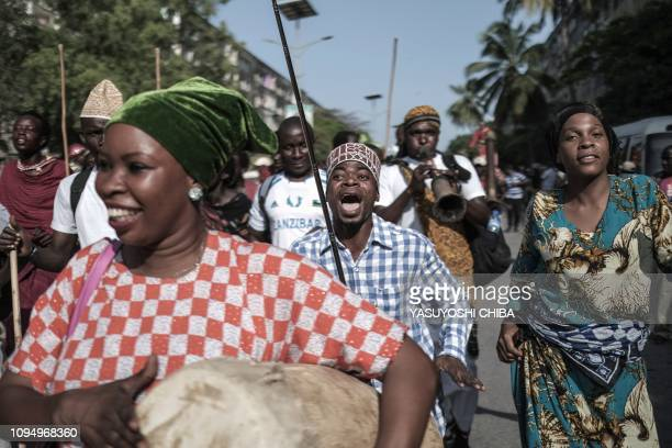 """Performers parade through the street to kick off the 16th International African music festival """"Sauti za Busara in Stone town on Tanzanias..."""