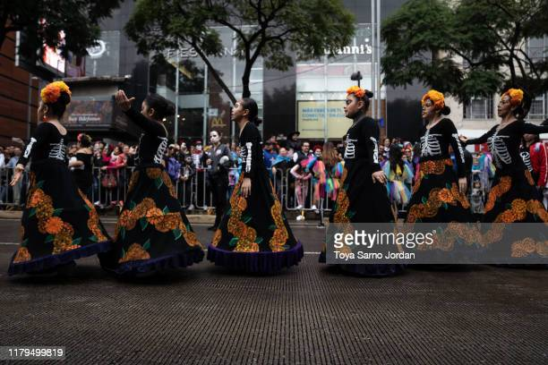 Performers participate in the Day of the Dead parade on Paseo de la Reforma Avenue on November 2 2019 in Mexico City Mexico Observants celebrate the...