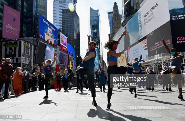 Performers participate in 'We Will Be Back', a live pop-up event and commemoration of Broadway's 'lost year' at Time Square on March 12, 2021 in New...