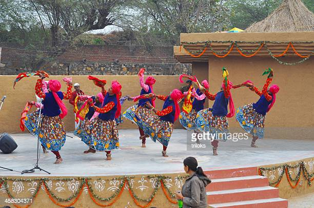 performers performing dance on stage - north indian food stock photos and pictures