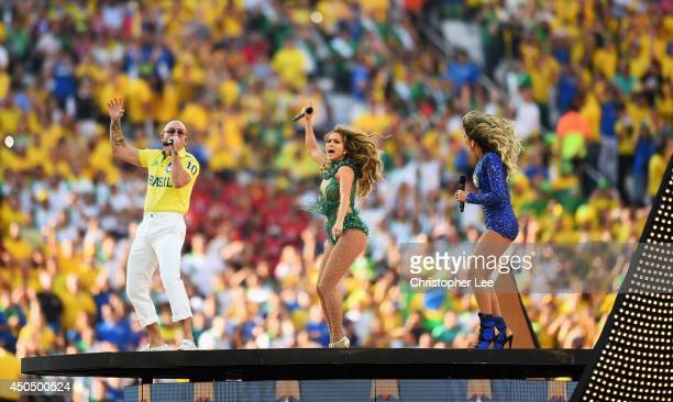 Performers Pitbull, Jennifer Lopez and Claudia Leitte perform during the Opening Ceremony of the 2014 FIFA World Cup Brazil prior to the Group A...