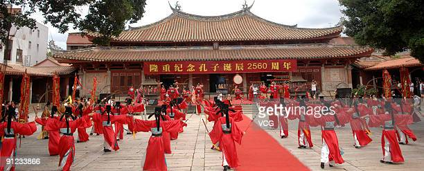 Performers play ritual music during a ceremony to mark Confucius' 2560th birthday at the Confucius Temple on September 28 2009 in Quanzhou Fujian...
