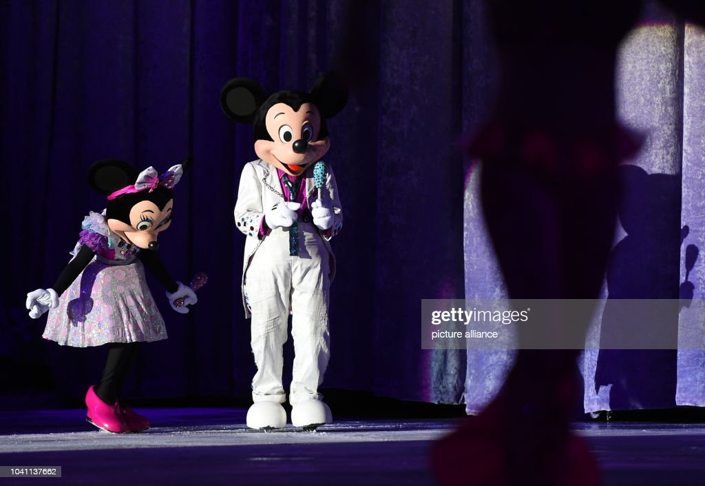 performers portray famous disney characters at the german premiere