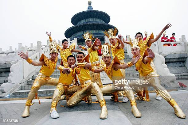 Performers pose for pictures during a rehearsal of the 2005 Fortune Global Forum Opening Ceremony at the Temple of Heaven on May 13, 2005 in Beijing,...