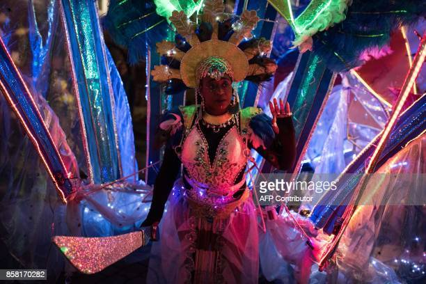 Performers prepare to take part in the Illuminated Night Carnival Parade which features in the annual 'Light Night Leeds' festival of visual arts in...