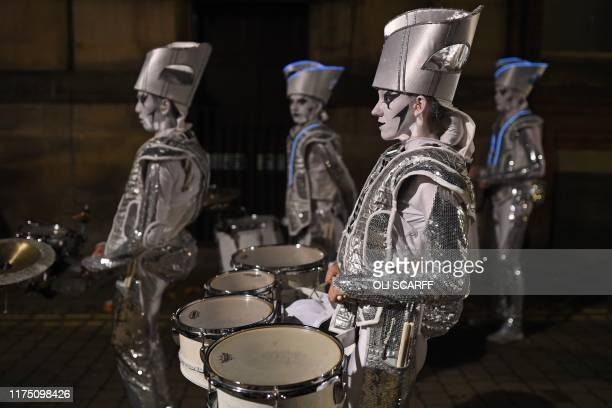 Performers prepare to take part in the When Dreams Run Wild Illuminated Parade which features in the annual 'Light Night Leeds' festival of visual...