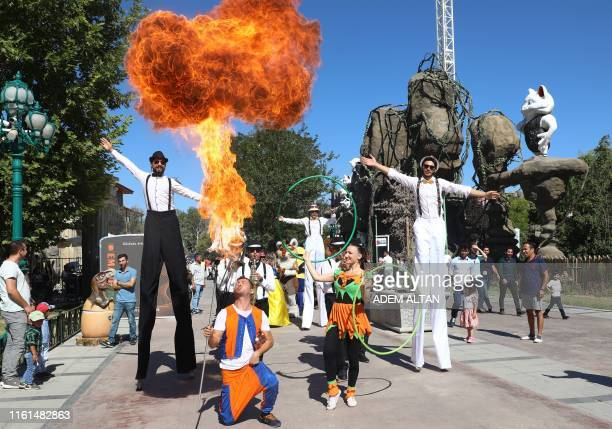 Performers put on a show in Wonderland Eurasia amusement park in Ankara on August 13 2019 on the third day of Eid alAdha celebrations Muslims across...
