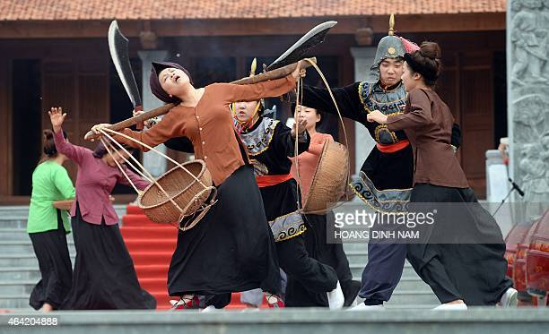 Performers reenact a scene showing Chinese troops invading Vietnam during a ceremony marking the 226th anniversary of a celebrated military victory...