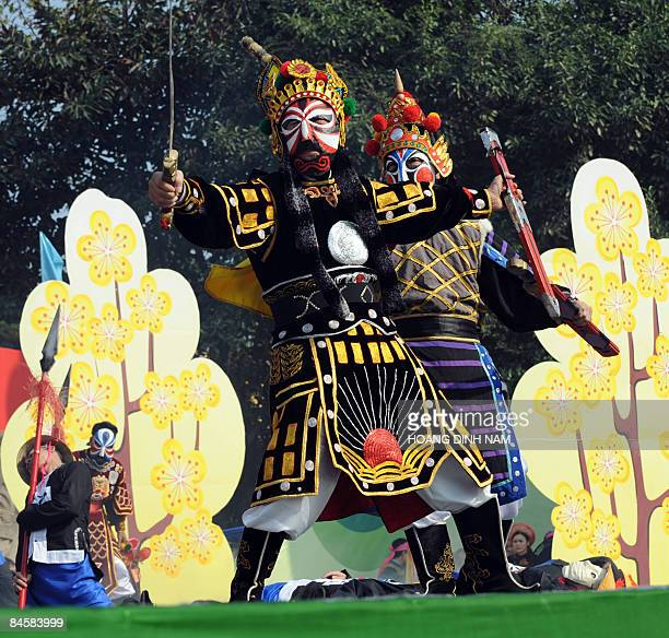 Performers reenact scenes showing Chinese Qing dynasty's troops invading Vietnam during celebrations held on January 30 2009 in Hanoi to mark the...