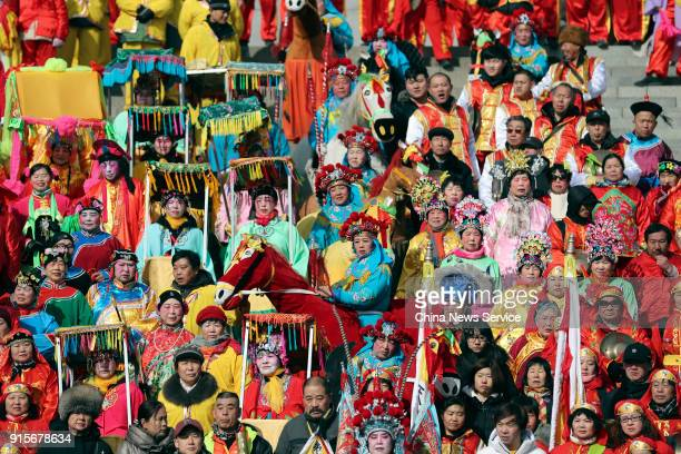 Performers rehearse during a temple fair at Badachu Park to welcome Lunar New Year on February 8 2018 in Beijing China The Lunar New Year which is...