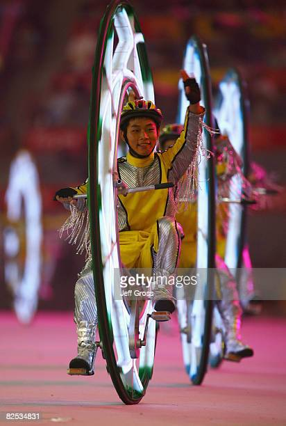 Performers ride a bicycle during the Closing Ceremony for the Beijing 2008 Olympic Games at the Beijing National Stadium on August 24, 2008 in...