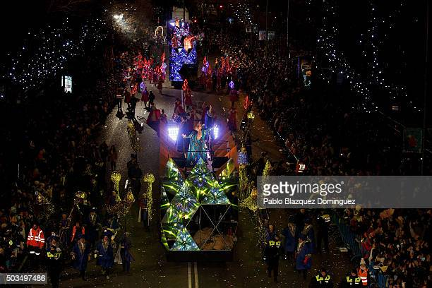 Performers ride floats during the 'Cabalgata de Reyes' or the Three Kings parade on January 5 2016 in Madrid Spain The traditional parade takes place...