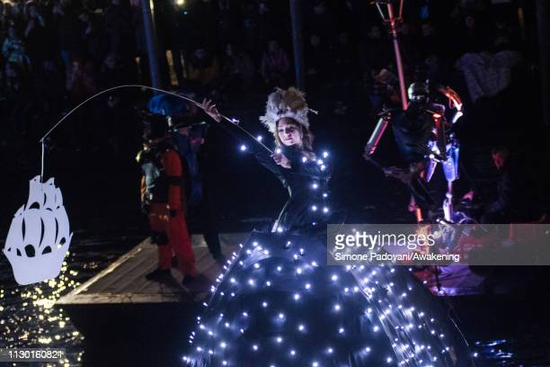 Performers sail along the Cannaregio Canal during the opening of the 2019 Venice Carnival on February 16, 2019 in Venice, Italy. The theme for the...
