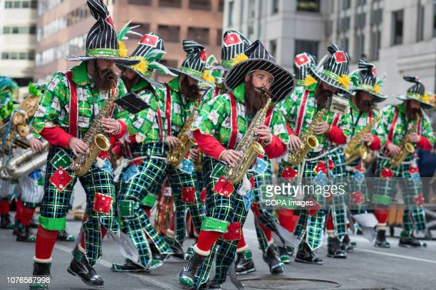 Performers seen playing music instrument during the Philadelphia Mummers Parade a New Years Day tradition Hundreds of performers comics and musicians...