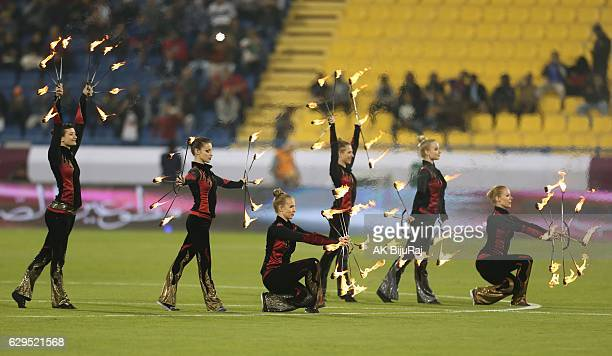 Performers show their skills before the Qatar Airways Cup match between FC Barcelona and Al-Ahli Saudi FC on December 13, 2016 in Doha, Qatar.