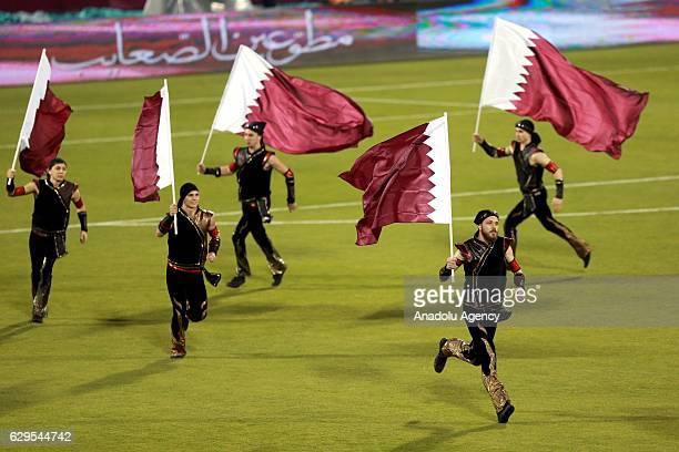 Performers show their skills prior to the friendly soccer match between Al-Ahli Saudi and Barcelona at Al-Gharrafa Stadium in Doha, Qatar on December...